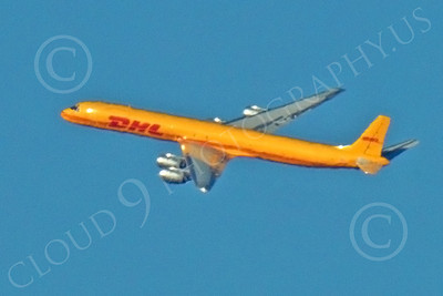 DC-8-C 00027 A distant, banking, in-flight DHL Douglas DC-8 jet, N801DH, by Peter J Mancus