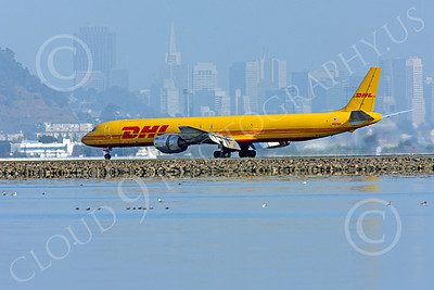 DC-8-C 00023 A DHL Douglas DC-8 jet, N801DH, rolling out after landing at SFO with San Francisco in the background, by Peter J Mancus