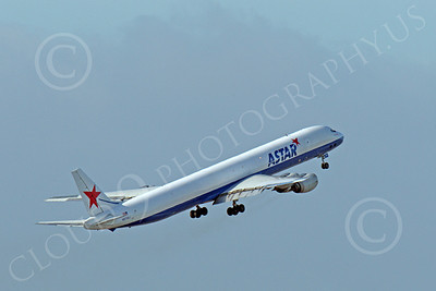 DC-8-C 00018 An ASTAR Air Cargo Douglas DC-8 jet, N873SJ, seen climbing for altitude after taking off at SFO, by Peter J Mancus