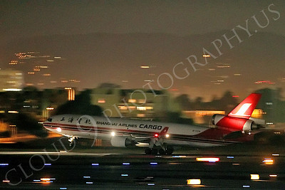 MD-11-C 00009 A Shanghai Airlines Cargo McDonald Douglas MD-11, B-2176, lands at night at LAX airliner picture, by Peter J Mancus