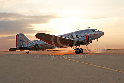 ALPPN 00007 A fantastic clutter free sunsrise picture of a Douglas DC-3 in American Airline Flagship markings during engine start-up, airplane picture, by Jay Shelby Davis