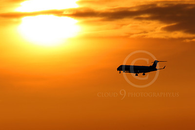 ALPSIL 00024 An Embraer ERJ145 airliner on final approach to land at sunrise, by Peter J Mancus