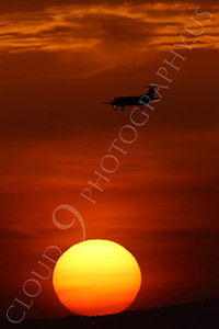 ALPSIL 00007 An Embraer EMB-120 Brasilia airliner on final approach to land at sunrise, by Peter J Mancus