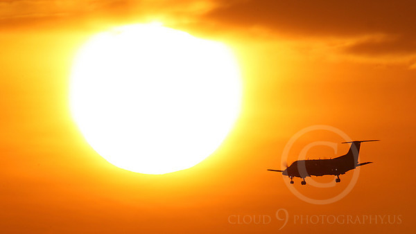 ALPSIL 00080 An Embraer EMB-120 Brasilia airliner on final approach to land at sunrise, by Peter J Mancus