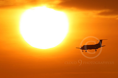 ALPSIL 00017 An Embraer EMB-120 Brasilia airliner on final approach to land at sunrise, by Peter J Mancus