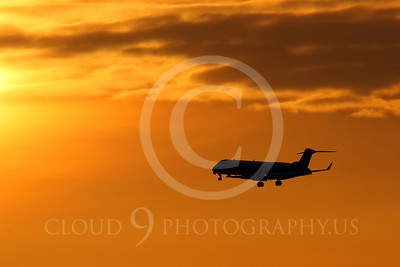 ALPSIL 00005 An Embraer ERJ145 airliner on final approach to land at sunrise, by Peter J Mancus
