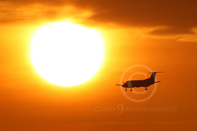 ALPSIL 00047 An Embraer EMB-120 Brasilia airliner on final approach to land at sunrise, by Peter J Mancus