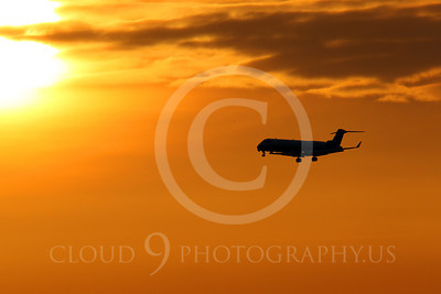 ALPSIL 00002 An Embraer ERJ145 airliner on final approach to land at sunrise, by Peter J Mancus
