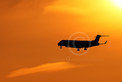 ALPSIL 00064 An Embraer ERJ145 airliner on final approach to land at sunrise, by Peter J Mancus