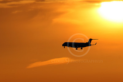 ALPSIL 00046 An Embraer ERJ145 airliner on final approach to land at sunrise, by Peter J Mancus