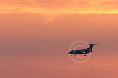 ALPSIL 00070 An Embraer EMB-120 Brasilia airliner on final approach to land at sunrise, by Peter J Mancus
