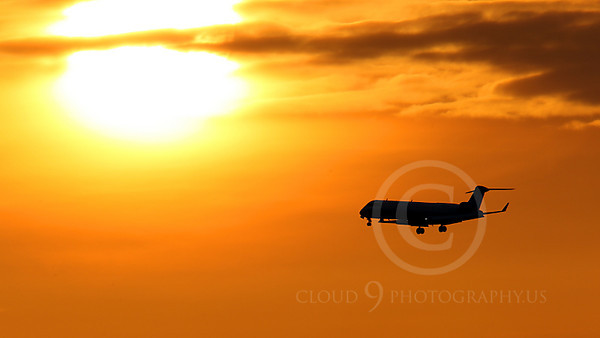 ALPSIL 00034 An Embraer ERJ145 airliner on final approach to land at sunrise, by Peter J Mancus