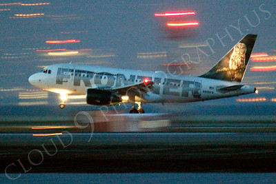 ALPN 00020 Frontier Airbus A318 landing at SFO in San Francisco at night, by Peter J Mancus