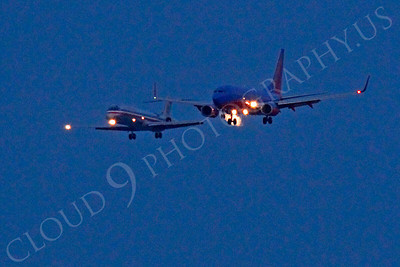 ALPN 00020 Two airliners landing in close proximity at SFO in San Francisco at night, by Peter J Mancus