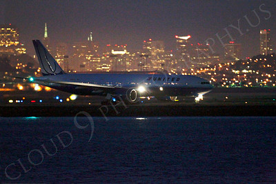 ALP-N 00009 United Airline Boeing 777 at SFO in San Francisco at night, by Peter J Mancus