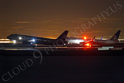 ALPN 00009 Two airliners land side by side at SFO in San Francisco at night, by Peter J Mancus