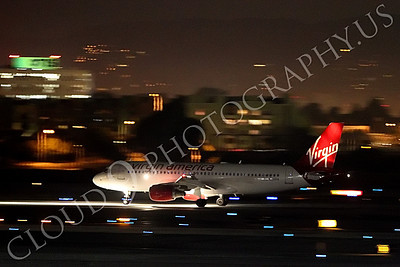 A319 00011 A Virgin America Airbus A319 begins its take off roll at LAX at night airliner picture, by Peter J Mancus