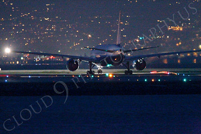 ALPN 00015 United Airline Boeing 777 waiting to take the runway at SFO in San Francisco at night, by Peter J Mancus