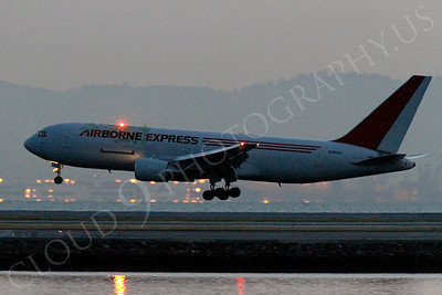 ALPN 00012 Airborne Express Boeing 767 N795AX  lands before sunrise at SFO in San Francisco, by Peter J Mancus