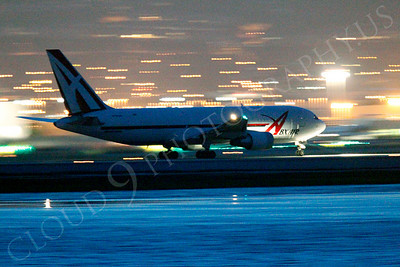 ALPN 00014 ABX Air Boeing 767 taking off at SFO in San Francisco at night, by Peter J Mancus