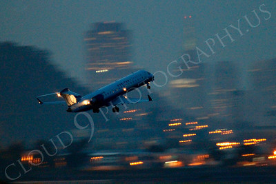 ALPN 00024 United Express Embraer ERJ 145 taking off at night at SFO in San Francisco, by Peter J Mancus