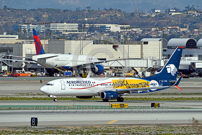 "AEE-B737-0007 A Boeing 737 AeroMexico XA-AME in special ""MUSICA SIN FRONTERAS"" markings jet airliner taxis at LAX 2015 airliner picture by Carl E  Porter"