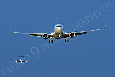 FFAL 00012 Heat waves from this Boeing 737 airliner create the illusion that the trailing airliner's right wing snapped off, airliner picture, by Peter J Mancus