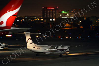 Bombardier Dash 8 Series 400 00001 A Horizon Air Bombardier Dash 8 Series 400, N432QX, taxies at night at LAX pass an A380's tail, airliner picture, by Peter J Mancus