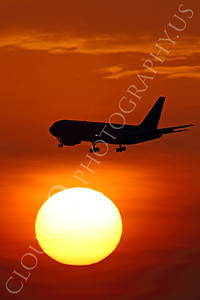 ALPSUN 00005 A Boeing 767 airliner flys pass a rising sun, by Peter J Mancus