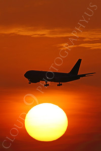 ALPSUN 00103 A Boeing 767 airliner on final approach to land flies above the sun at sunrise, by Peter J Mancus