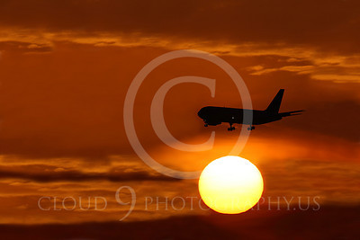 ALPSUN 00118 A Boeing 767 airliner on final approach to land flies above the sun at sunrise, by Peter J Mancus