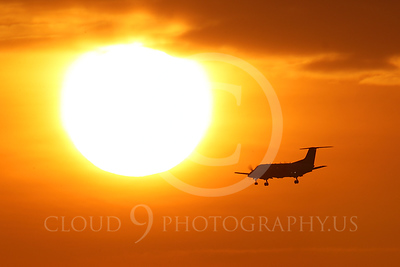 ALPSUN 00047 An Embraer EMB-120 Brasilia airliner on final approach to land at sunrise, by Peter J Mancus