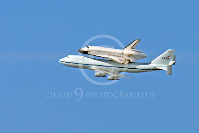 NASA-Space Shuttle 00022 A long distance big telephoto lens picture of a distant space shuttle Endeavour in flight on a NASA Boeing 747 N905NA on its last flight on September 21, 2012, by Peter J Mancus