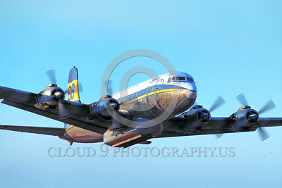 FF-DC-7 00012 A flying Douglas DC-7 Butler Aircraft Co fire fighting airplane picture by Peter J Mancus