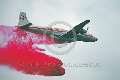 FF-DC-7 00008 A flying Douglas DC-7 Conair Aviation drops anti-fire retardant Canada 9-1978 fire fighting airplane picture by Peter J Mancus