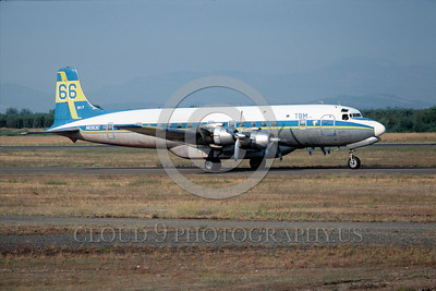 FF-DC-7 00001 A taxing Douglas DC-7 N6353C 8-1977 fire fighting airplane picture by Peter B Lewis