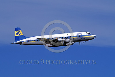 FF-DC-7 00010 A flying Douglas DC-7 Butler Aircraft Co N6353C fire fighting airplane picture by Peter J Mancus