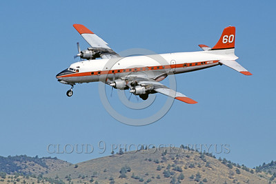 FF-DC-7 00018 A landing Douglas DC-7 N838D fire fighting airplane picture by Peter J Mancus