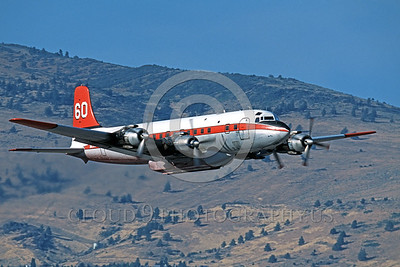 FF-DC-7 00020 A low flying Douglas DC-7 N838D fire fighting airplane picture by Peter J Mancus