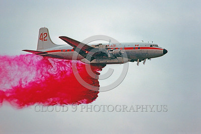 FF-DC-7 00004 A flying Douglas DC-7 Conair drops anti-fire retardant Canada 9-1978 fire fighting airplane picture by Peter J Mancus