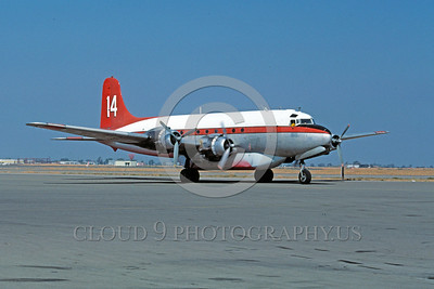 FF-DC-6 00001 A static Douglas DC-6 fire fighting airplane picture 9-1987 by Peter B Lewis
