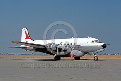 FF-DC-6 00003 A taxing Douglas DC-6 fire fighting airplane picture 9-1987 by Peter B Lewis