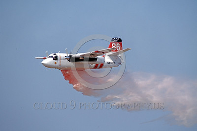 FF-S-2 00004 A flying Grumman S-2 Turbo Tracker CDF California Department of Forestry N433DF drops water or retardent fire fighting airplane picture by Peter J Mancus