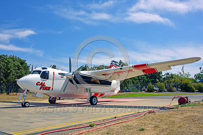 FF-S-2 00011 A quarter front view of a static Grumman S-2 Tracker ex-anti-submarine warfare airplane now Cal Fire 85 Santa Rosa 8-2015 fire fighting airplane picture by Peter J Mancus