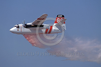 FF-S-2 00020 A flying Grumman S-2 Turbo Tracker CDF California Department of Forestry N433DF makes a water or retardent drop fire fighting airplane picture by Peter J Mancus
