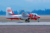 FF-S-2 00033 A taxing piston powered Grumman S-2 Tracker Conair C-GWUP Abottsford 3-1990 fire fighting airplane picture by Peter J Mancus