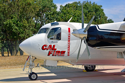 FF-S-2 00013 A quarter front view of a static Grumman S-2 Tracker ex-anti-submarine warfare airplane now Cal Fire 85 Santa Rosa 8-2015 fire fighting airplane picture by Peter J Mancus