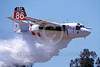 FF-S-2 00014 A flying Grumman S-2 Turbo Tracker CDF California Department of Forestry N433DF makes a water or retardent drop fire fighting airplane picture by Peter J Mancus