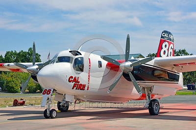 FF-S-2 00015 A quarter front view of a static Grumman S-2 Tracker ex-anti-submarine warfare airplane now Cal Fire 86 Santa Rosa 8-2015 fire fighting airplane picture by Peter J Mancus