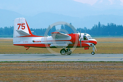 FF-S-2 00037 A taxing piston powered Grumman S-2 Tracker Conair C-FEFX Abottsford 3-1990 fire fighting airplane picture by Peter J Mancus